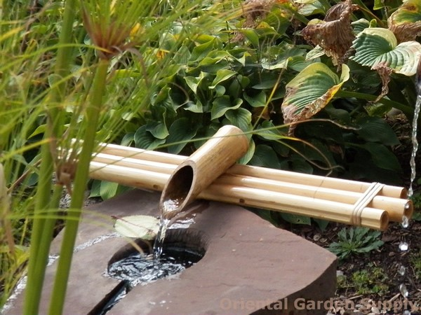 Basin Bamboo Spout over water